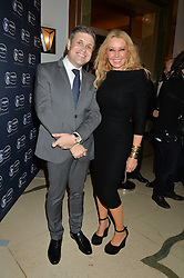JUAN-CARLOS CAPELLI VP and head of international marketing for Longines and CAROL VORDERMAN at the Longines World's Best Racehorse Awards 2014 hosted by Longines and the International Federation of Horseracing Authorities held at Claridge's, Brook Street, London on 20th January 2015.