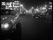 Car Bomb Damage in Dublin (E10)..1972.02.12.1972..12.02.1972..2nd December 1972..On the morning of 2nd December '72 two car bombs exploded in Dublin City. At Sackville Place two busmen were killed as they waited in their car to resume work. The busmen were named as George Bradshaw (30) and Thomas Duffy (23). The bomb was thought to be planted by a Northern Ireland subversive group who hoped to influence legislation going through Dail Eireann in relation to the I.R.A...Picture of Garda cars on O'Connell Street, blocking access to the scene of the explosions.