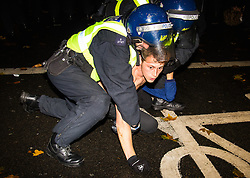 London, November 5th 2015.  Anarchists and anti-establishment activists hold their annual Million Mask March on Guy Fawkes night, enduring rain and a heavy police presence. The marches origins lie with the online activism group Anonymous.