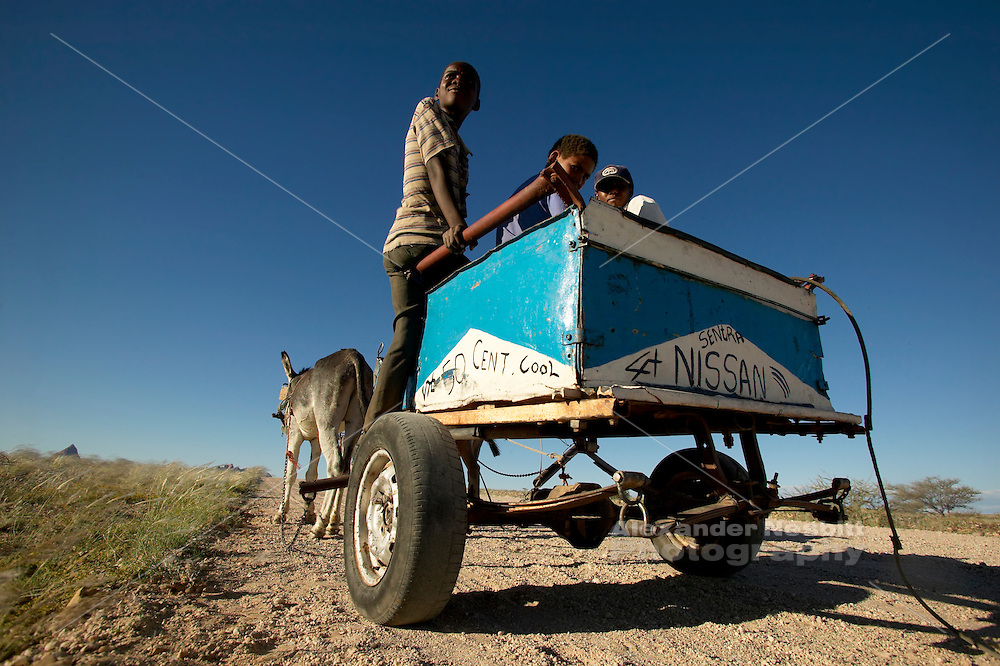 "Namibia, 2004 - Boys with a donkey cart on which they have painted ""4x4"" and ""Nissan Sentra"""