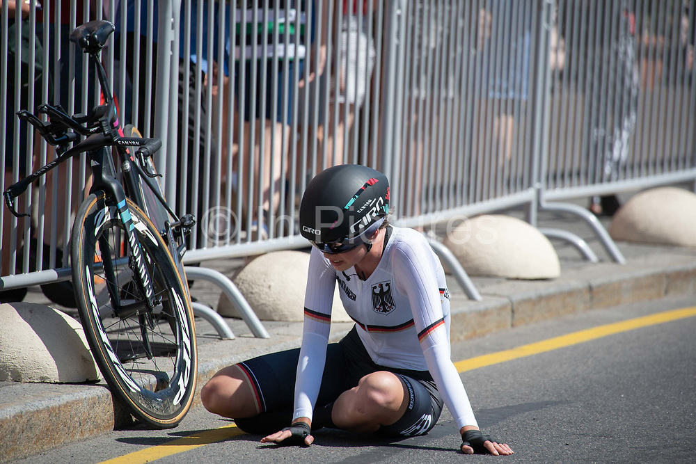 An exhausted Christa Riffel, Germany, following the women's cycling time trails during the 2019 Minsk European Games on the 25th June 2019 in Minsk City in Belarus.