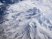Low cumulus clouds climb up the southeast face of Mount Shasta in this aerial view taken from above the 14,179-foot (4321 meter) volcano located in the Cascade Range in California.