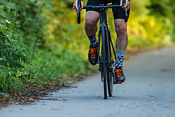 Male Cyclist Cycling on Country Road, Low section