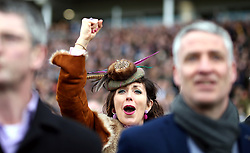 A female racegoer reacts watching the action from the RSA Insurance Novices' Chase during Ladies Day of the 2018 Cheltenham Festival at Cheltenham Racecourse. PRESS ASSOCIATION Photo. Picture date: Wednesday March 14, 2018. See PA story RACING Cheltenham. Photo credit should read: Steven Paston/PA Wire. RESTRICTIONS: Editorial Use only, commercial use is subject to prior permission from The Jockey Club/Cheltenham Racecourse.