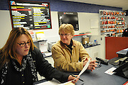 """TA Truck Service Center Assistant General Manager Bill Farntz (R) checks in with front-office Technical Service Advisor DeDe Mclaughlin in Morris, Illinois. Farntz credits Mclaughlin as the service facility's de-facto boss who gets things done, though it's sometimes best to """"stay out of her way""""."""
