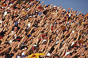 Fans doing the wave.