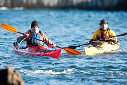 Scottish Sun sports editor Iain King takes part in a practise session for his charity kayak challenge, in the waters of the harbour at St Abbs. With Richard Harpham..Pic © Michael Schofield...