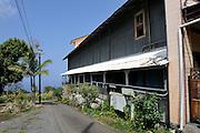 Lane and exterior side wall of the Aloha Theatre in Kainaliu. Kona, Big Island, Hawaii