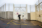 An officer unlocks a gate inside HMP/YOI Portland, a resettlement prison with a capacity for 530 prisoners. Dorset, United Kingdom.
