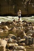 Photographer Ralph Lee Hopkins (release on file) photographs the Colorado River, Grand Canyon National Park, Arizona, US