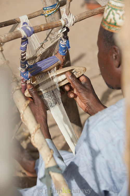 Cotton weavers work in the village of Rhumsiki, Cameroon