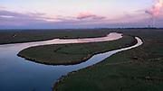 Nederland, Zeeuws-Vlaanderen, Nieuw-Namen, 05–11-2020; Emmadorp, Het Verdonken Land van Saeftinghe,  getijdengebied in het oosten Zeeuws-Vlaanderen op de grens met Belgie en onderdeel van het estuarium van de Schelde. Hertogin Hedwigepolder en haven Antwerpen met kerncentrale Doel in de achtergrond. De voormalige polder is het grootste brakwatergebied van Europa en staat onder invloed van het getij. Het Verdronken Land is een natuurreservaat, in beheer bij het Zeeuws Landschap en belangrijk als broed-, overwinterings- en rustgebied voor vogels. <br /> The Drowned Land of Saeftinghe, tidal area in the east of Dutch Flanders on the border with Belgium. The former polder is the largest brackish water of Europe and because of the the tides, there are mud flats and gullies. The Drowned Land is a nature reserve, not freely accessible. It is managed by the Zeeuws Landscape and important as bird sanctuary, part of the Scheldt estuary.<br /> drone-opname (luchtopname, toeslag op standaard tarieven);<br /> drone recording (aerial, additional fee required);<br /> copyright foto/photo Siebe Swart