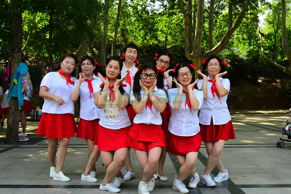 June 1, 2017 - Zhengzh, Zhengzh, China - Zhengzhou, CHINA-June 1 2017: (EDITORIAL USE ONLY. CHINA OUT)..Hundreds of middle-aged women wearing red scarves and white blouses celebrate Children's Day in Zhengzhou, central China's Henan Province, June 1st,2017. (Credit Image: © SIPA Asia via ZUMA Wire)