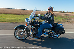 Michaela Glugla of Aberdeen, SD riding her Harley-Davidson Softail Deluxe in the USS South Dakota submarine flag relay across South Dakota. Groton, SD. USA. Sunday October 8, 2017. Photography ©2017 Michael Lichter.