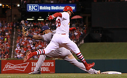 September 29, 2017 - St Louis, MO, USA - The St. Louis Cardinals' Tommy Pham stretches for the first base bag as Milwaukee Brewers first baseman Eric Thames catches the throw for the out in the fourth inning on Friday, Sept. 29, 2017, at Busch Stadium in St. Louis. The Brewers won, 5-3. (Credit Image: © Chris Lee/TNS via ZUMA Wire)