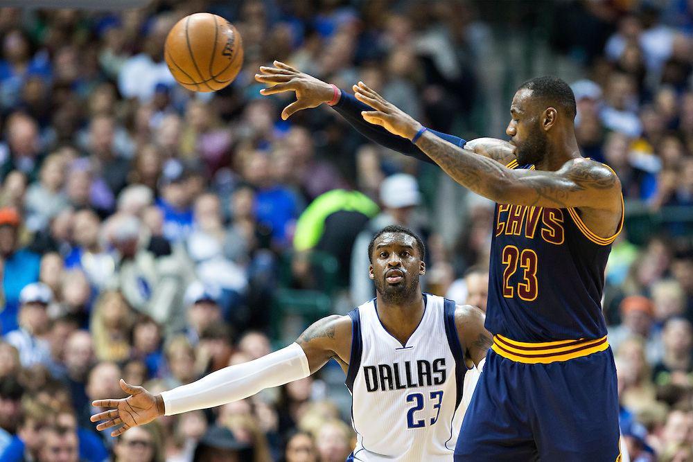 DALLAS, TX - JANUARY 12:  Lebron James #23 of the Cleveland Cavaliers makes a pass while being defended by Wesley Matthews #23 of the Dallas Mavericks at American Airlines Center on January 12, 2016 in Dallas, Texas.  NOTE TO USER: User expressly acknowledges and agrees that, by downloading and or using this photograph, User is consenting to the terms and conditions of the Getty Images License Agreement.  The Cavaliers defeated the Mavericks 110-107.  (Photo by Wesley Hitt/Getty Images) *** Local Caption *** Lebron James; Wesley Matthews