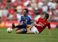 Photo: Rich Eaton.<br /> <br /> Manchester United v Chelsea. FA Community Shield. 05/08/2007. Chelsea's Frank Lampard (l) is tackled by Michael Carrick (r)