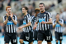 Jack Colback and Steven Taylor of Newcastle United applaud the fans after thier sides 1-0 win - Photo mandatory by-line: Rogan Thomson/JMP - 07966 386802 -01/11/2014 - SPORT - FOOTBALL - Newcastle, England - St James' Park - Newcastle United v Liverpool - Barclays Premier League.