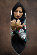 Saima Qureshi prays during a special prayer with non-Muslim members of the community Monday, June 13, 2016, in Longwood, Fla., after the mass-shooting at the Pulse Orlando nightclub. Dozens of people were killed at the gay nightclub in the deadliest shooting in modern U.S. history. (AP Photo/Phelan M. Ebenhack)