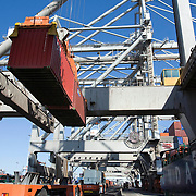 Nederland Zuid-Holland Rotterdam  27-08-2009 20090827 Foto: David Rozing .Serie over logistieke sector.ECT Delta terminal in de haven van Rotterdam. Robotgestuurde wagens vervoeren de containers op de terminal. Onbemande wagens in de rij bij de hijskranen, deze tillen de containers op het zeeschip. .ECT,European Container Terminals, at the Port of Rotterdam. Europe's biggest and most advanced container terminal operator, handling close to three- quarters of all containers passing through the Port of Rotterdam. ECT is a member of the Hutchison Port Holdings group (HPH), the world biggest container stevedore with terminals on every Continent. At the ECT Delta Terminal unmanned, automated guided vehicles  so called AGVs  transport the containers between ship and stack. In the stack, unmanned automated stacking cranes ( ASCs ) ensure that the containers are always stacked in the correct place. Terminal operations are highly automated for discharging and loading large volumes , wagen, wagens, wagon, wagons, wereldhandel, werk, werkzaamheden, zeehaven, zeehavens..Holland, The Netherlands, dutch, Pays Bas, Europe .Foto: David Rozing