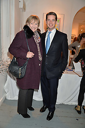 LADY TOLLEMACHE and her son the HON.JAMES TOLLEMACHE at an exhibition of works by Beatrice von Preussen held at The Gallery on The Corner, 155 Battersea Park Road, London SW8 on 11th December 2013.