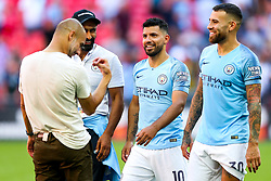 Sergio Aguero and Nicolas Otamendi share a joke with manager Pep Guardiola as Manchester City celebrate winning the Community Shield with a 2-0 victory over Chelsea - Rogan/JMP - 05/08/2018 - FOOTBALL - Wembley Stadium - London, England - Chelsea v Manchester City - The FA Community Shield.