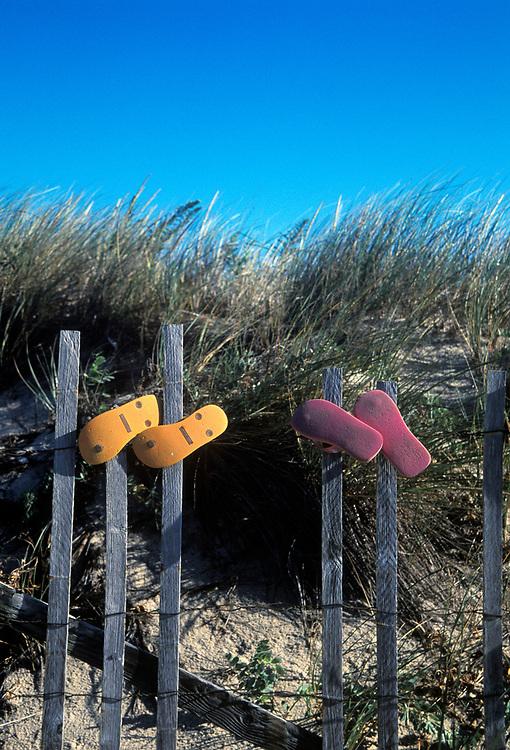 Flip flops hanging on a beach dune fence, Wellfleet, Cape Cod, MA