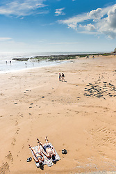 Sunbathers on a beach at Broadstairs in Kent.