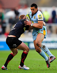 Northampton Inside Centre (#12) Luther Burrell is tackled by Dragons Full Back (#15) Tom Prydie during the first half of the match - Photo mandatory by-line: Rogan Thomson/JMP - Tel: Mobile: 07966 386802 18/11/2012 - SPORT - RUGBY - Rodney Parade - Newport. Newport Gwent Dragons v Northampton Saints - LV= Cup Round 2