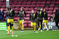 Burton Albion warm up for the The FA Cup 1st round match between Scunthorpe United and Burton Albion at Glanford Park, Scunthorpe, England on 10 November 2018.