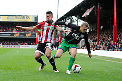 Luke Freeman of Bristol City challenges for the ball with Nico Yennaris of Brentford - Mandatory by-line: Dougie Allward/JMP - 16/04/2016 - FOOTBALL - Griffin Park - Brentford, England - Brentford v Bristol City - Sky Bet Championship