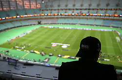 A general view of a volunteer wearing a Baku Final cap ahead of the match during the UEFA Europa League final at The Olympic Stadium, Baku, Azerbaijan.