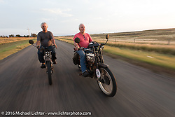 Doug Feinsod (L) of California riding his 1913 Thor beside Steve Gonzales of California on his 1915 Harley-Davidson in Dodge City during the Motorcycle Cannonball Race of the Century. Stage-8 from Wichita, KS to Dodge City, KS. USA. Saturday September 17, 2016. Photography ©2016 Michael Lichter.