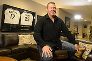 CHICAGO - JANUARY 24:  Former Major League player Jim Thome conducts an interview after receiving a phone call from the National Baseball Hall of Fame in Cooperstown, New York, informing him that he has been elected to the Hall of Fame. Jim accepted the call while surrounded by his family, wife Andrea and children Lila Grace and Landon. (Photo by Ron Vesely)  Subject: Jim Thome