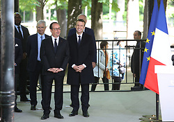 May 10, 2017 - Paris, FRANCE - Outgoing French President Francois Hollande (L) and President-elect Emmanuel Macron attend the commemoration ceremony of the abolition of slavery at the Luxembourg Gardens in Paris on 10 May 2017.  The ceremony is Hollande's last as head of state before the transfer of power next Sunday. (Credit Image: © Maya Vidon-White via ZUMA Wire)