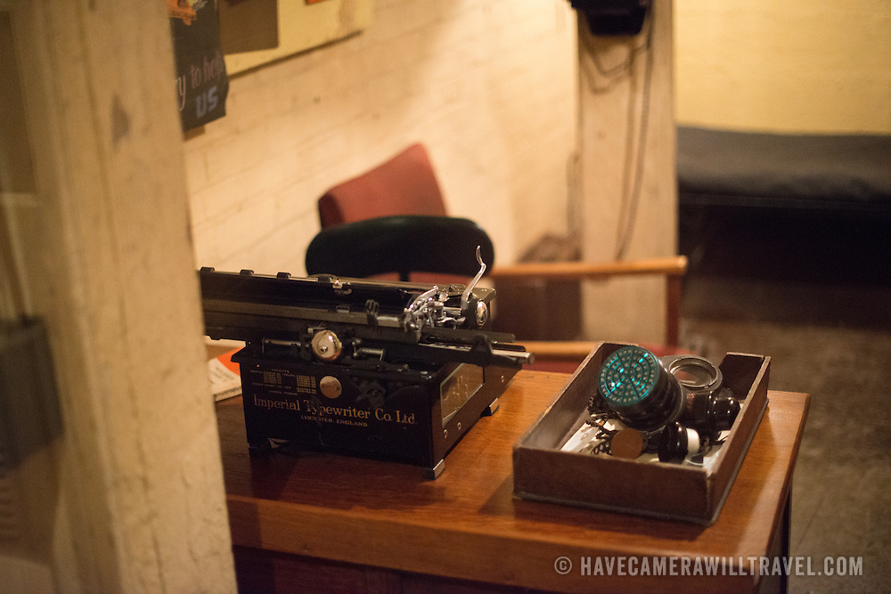 A typewriter on a small desk in a combined sleeping and office quarters at the Churchill War Rooms in London. The museum, one of five branches of the Imerial War Museums, preserves the World War II underground command bunker used by British Prime Minister Winston Churchill. Its cramped quarters were constructed from a converting a storage basement in the Treasury Building in Whitehall, London. Being underground, and under an unusually sturdy building, the Cabinet War Rooms were afforded some protection from the bombs falling above during the Blitz.