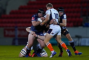 Sale Sharks prop Bevan Rodd is held by Edinburgh Rugby stand-off Jaco van der Walt during the European Champions Cup match Sale Sharks -V- Edinburgh Rugby at The AJ Bell Stadium, Greater Manchester,England United Kingdom, Saturday, December 19, 2020. (Steve Flynn/Image of Sport)