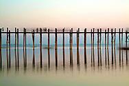 The 1.2 kilometre U Bein Bridge is believed to be the oldest and longest teakwood bridge in the world, crossing the Taungthaman Lake near Mandalay in Myanmar. Photo by Lorenz Berna