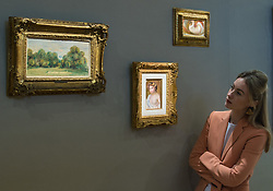 Bonhams, London, February 27th 2017. A woman admires three small paintings by Augustine Renoir including Jeune femme en buste (£150,000-200,000), 'Nu Allongé' (£40,000-80,000) and La party de tennis (£70,000-100,000) at the Bonhams impressionist and modern art sale press preview at their Mayfair gallery in London.