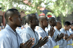 DENGFENG, Sept. 24, 2016 (Xinhua) -- African apprentices attend the graduation ceremony at the Shaolin Temple on the Songshan Mountain in Dengfeng City, central China's Henan Province, Sept. 23, 2016. A total of twenty apprentices from Africa graduated here on Friday after three-month training programs on Kungfu and Shaolin culture. (Xinhua/Feng Dapeng)(wyo) (Credit Image: © Feng Dapeng/Xinhua via ZUMA Wire)