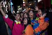 Young Japanese women in costume take a selfie during the Halloween celebrations in Shibuya, Tokyo, Japan. Wednesday October 31st 2018 .  Halloween has grown massively popular  in Japan over the last few yers. Primarily an event for young adults who use it as a chance to dress up in inventive costumes and spend the night partying . In recent years the misbehaviour of some revellers has caused a heavier police presence on the street and  a push back from the Japanese society, and media  who see no need for nor benefits to this western cultural import.