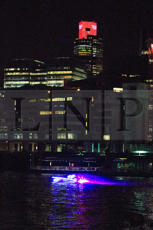 © Licensed to London News Pictures. 25/07/2012. London, UK. A colourful illuminated boat passes the Nat West Tower in London on 24 July 2012 in a rehearsal event believed to be related to the opening ceremony of the London 2012 Olympic Games. Photo credit : Vickie Flores/LNP