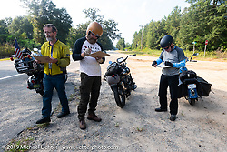Brian Pease, Jeff Durrant and Gary Shorman fill out the roadside pop quiz during the Cross Country Chase motorcycle endurance run from Sault Sainte Marie, MI to Key West, FL. (for vintage bikes from 1930-1948). Stage-7 covered 249 miles from Macon, GA to Tallahassee, FL USA. Thursday, September 12, 2019. Photography ©2019 Michael Lichter.