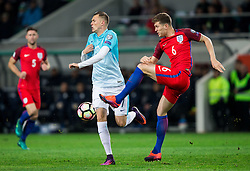 Josip Ilicic of Slovenia vs John Stones of England during football match between National teams of Slovenia and England in Round #3 of FIFA World Cup Russia 2018 Qualifier Group F, on October 11, 2016 in SRC Stozice, Ljubljana, Slovenia. Photo by Vid Ponikvar / Sportida