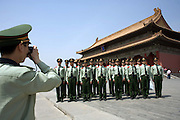 A brigade of soldiers from China's Peoples Liberation Army pose for a group portrait in the Forbidden City in Beijing.