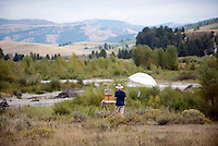 Andy Taylor, of Napels, Florida, plein air paints a scene of the Gros Ventre River and the mountains beyond Sunday in Grand Teton National Park.