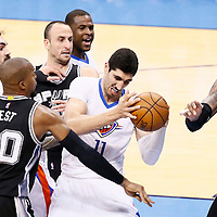 06 May 2016: Oklahoma City Thunder center Enes Kanter (11) vies for the rebound with San Antonio Spurs forward David West (30) next to Oklahoma City Thunder center Steven Adams (12), San Antonio Spurs guard Manu Ginobili (20) and San Antonio Spurs forward LaMarcus Aldridge (12) during the San Antonio Spurs 100-96 victory over the Oklahoma City Thunder, during Game Three of the Western Conference Semifinals of the NBA Playoffs at the Chesapeake Energy Arena, Oklahoma City, Oklahoma, USA.