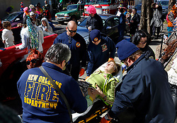 09 February 2016. New Orleans, Louisiana.<br /> Mardi Gras Day. EMS arrive to carry a woman to the ER following what appeared to be overindulgence on the day.<br /> Photo©; Charlie Varley/varleypix.com
