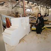 """VENICE, ITALY - JUNE 02:  Artist Reem Al Ghaith poses within her installation """"What's left of her land"""" inside the United Arab Emirates pavillion on June 2, 2011 in Venice, Italy. This year's Biennale is the 54th edition and will run from June 4th until 27 November."""