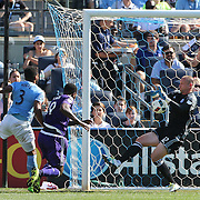 NEW YORK, NEW YORK - May 29:  Goalkeeper Josh Saunders #12 of New York City FC make a fine save from a header from Cyle Larin #9 of Orlando City FC during the New York City FC Vs Orlando City, MSL regular season football match at Yankee Stadium, The Bronx, May 29, 2016 in New York City. (Photo by Tim Clayton/Corbis via Getty Images)